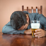 Drunk man sleeping on a table Stock Photography