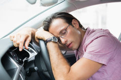 Drunk man slumped on steering wheel Stock Photography