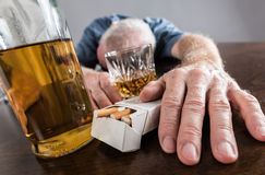 Drunk man slumped on table Royalty Free Stock Photography