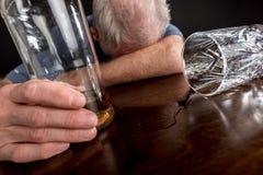 Drunk man slumped on table Stock Image