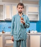 Drunk man standing in pajamas with glass Stock Photography