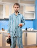 Drunk man standing in pajamas with onion Royalty Free Stock Images
