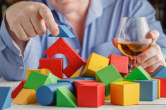 Drunk man is suit addicted to alcohol Stock Images