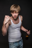 Drunk man threaten with fist Royalty Free Stock Image