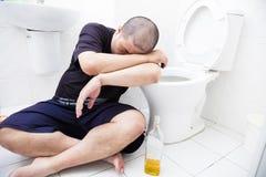 Drunk man with wine bottle in toilet. Drunk fat man with wine bottle in toilet stock photos