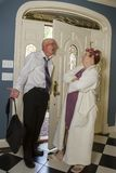 Drunk man meets angry wife at front door Royalty Free Stock Photo