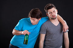 Drunk men friends Stock Photo