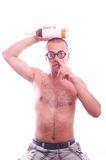 Drunk nerd in eyeglasses picking his nose Royalty Free Stock Photos