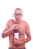 Drunk nerd guy in eyeglasses Royalty Free Stock Photos