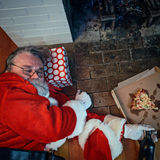 Drunk and Passed Out Santa Claus. Santa partied too hard at this house Royalty Free Stock Photos