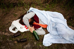 Drunk Person. A homeless drunk person laying by the edge of the road stock photos