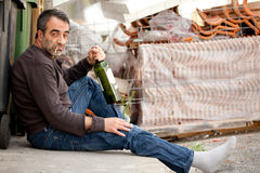 Drunk sad man Stock Images