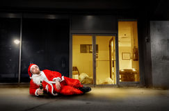 Drunk santa. Claus out of a house royalty free stock images