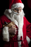 Drunk santa. A drunk santa with a liquer bottle in a brown paper bag Stock Photography