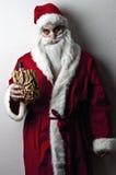 Drunk santa. A drunk santa with a liquer bottle in a brown paper bag stock photos