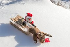 Drunk Santa Claus with empty bottle on the sled. Drunk Santa Claus with empty bottle on the wooden sled royalty free stock photography