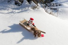 Drunk Santa Claus with empty bottle on the sled. Drunk Santa Claus with empty bottle on the wooden sled stock photography