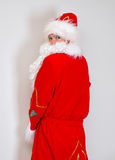Drunk Santa Claus. Drunk Santa Claus pee on the wall royalty free stock image