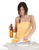 Drunk smoking young woman ironing clothes Stock Images