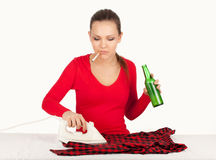 Drunk smoking young woman ironing clothes Royalty Free Stock Images