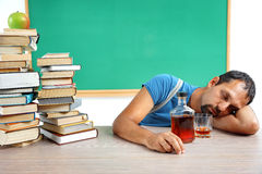 Drunk teacher fall asleep at classroom. Stock Image