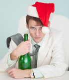 Drunk and tired guy celebrates Christmas Royalty Free Stock Photos