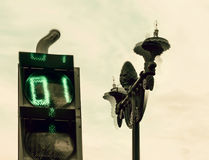 Drunk traffic ight and lantern. Strange traffic light and lantern at cloudy day Royalty Free Stock Photography