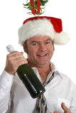 Drunk Under Mistletoe Royalty Free Stock Photography