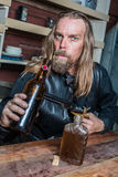 Drunk Western Man at Table Stock Photography