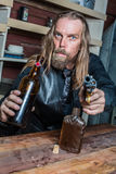Drunk Western Man at Table Royalty Free Stock Photo