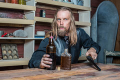 Drunk Western Man at Table Royalty Free Stock Images