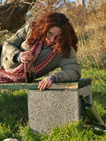 Drunk woman 3. Portrait of a young woman drunk with a bottle of alcohol in his hand lying on a park bench. Vertical color photo Stock Photo
