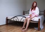 Drunk woman with alcohol. In depression Royalty Free Stock Photo