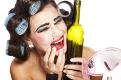 Drunk woman with curlers Royalty Free Stock Photo