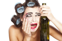 Drunk woman with curlers Royalty Free Stock Photography
