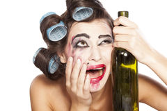 Drunk woman with curlers Royalty Free Stock Photos