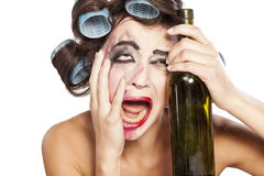 Drunk woman with curlers Royalty Free Stock Image