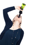 Drunk woman drinking wine. Portrait of young drunk woman drinking wine, isolated on white background Stock Image