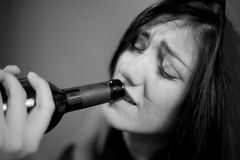 Drunk woman drinking wine crying black and white Stock Photos