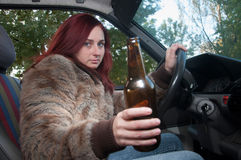 Drunk woman driving car Royalty Free Stock Photography