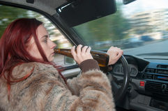 Drunk woman driving car Stock Images