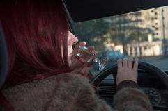 Drunk woman driving car Stock Photo