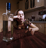 Drunk woman falling asleep with glass of alcoholic drink Stock Photography