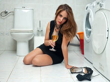 Drunk woman in her bathroom Royalty Free Stock Photography
