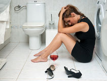 Drunk woman in her bathroom stock image