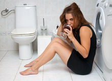 Drunk woman in her bathroom Stock Images