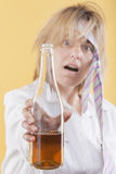 Drunk woman holding bottle. Royalty Free Stock Images