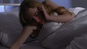 Drunk woman lying to sleep with empty bottle, alcohol addiction, binge drinking. Stock footage stock video footage