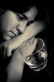 Drunk woman with a sad expression Stock Image
