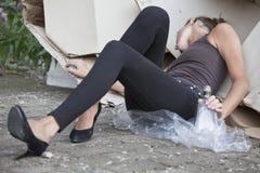 Drunk woman sleeping in cartons stock photos